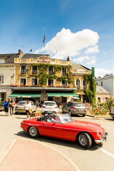 Hotel de France exterior classic MG driving away