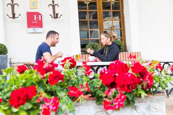 Couple on terrace bar Hotel de France near Le Mans and Loire Valley